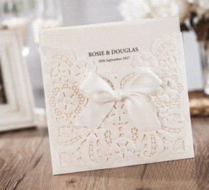 50 Cecilia Personalised White pearlised flower and scroll wallet Invitations £3.73 each